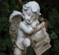 Holistic Life Coaching - get insights from your book of life, watched over by your guardian angel. Photo of angel resting over a book.